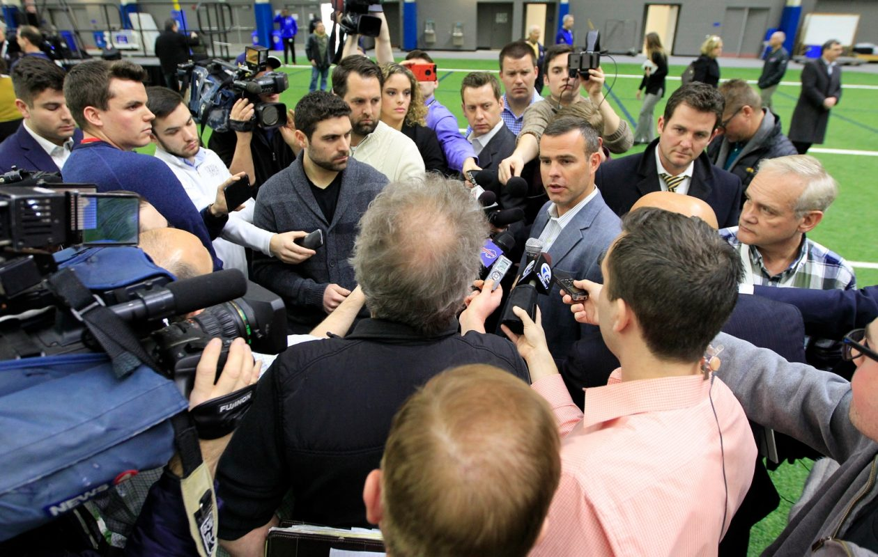 Reporters surround Bills general manager Brandon Beane following Eric Wood's press conference. (Harry Scull Jr./Buffalo News)