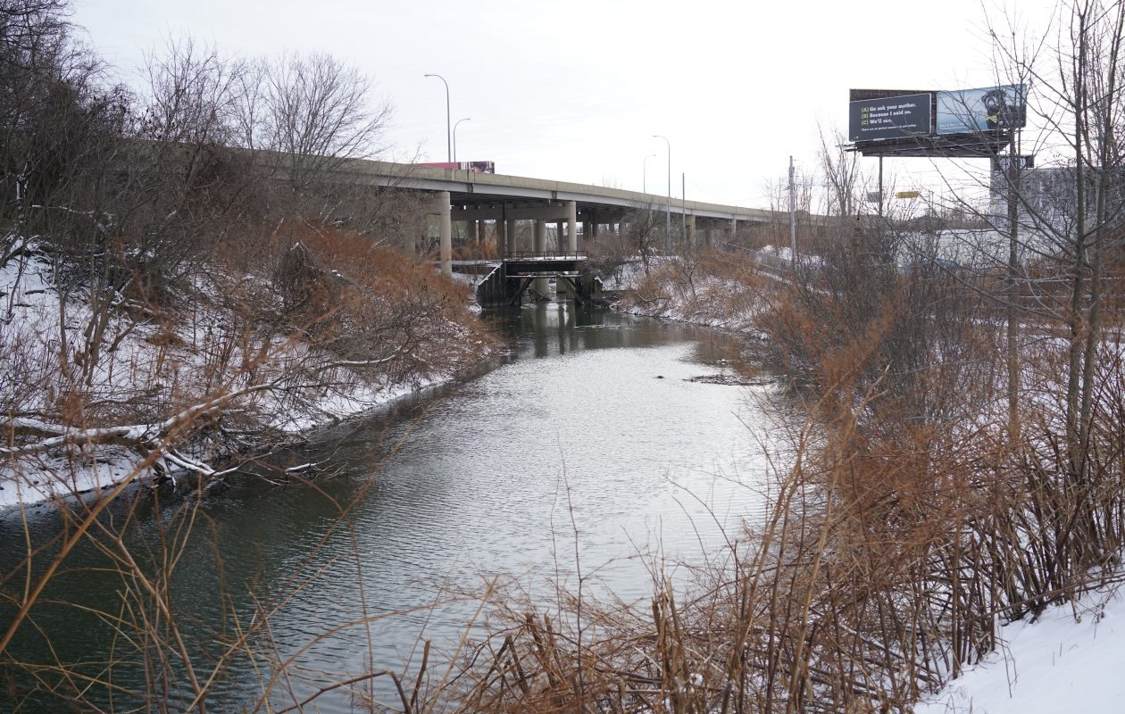 Scajaquada Creek as it flows underneath Route 198 in Buffalo received millions of gallons of Cheektowaga's sewage and stormwater Thursday. (Derek Gee/Buffalo News)