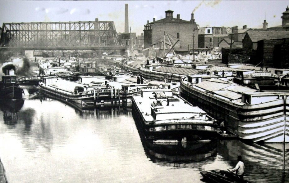 Canal boats are stuck in traffic in 1890 in Buffalo, looking from Erie Street toward Genesee Street. (Photo courtesy of the WNY Heritage Institute Collection)