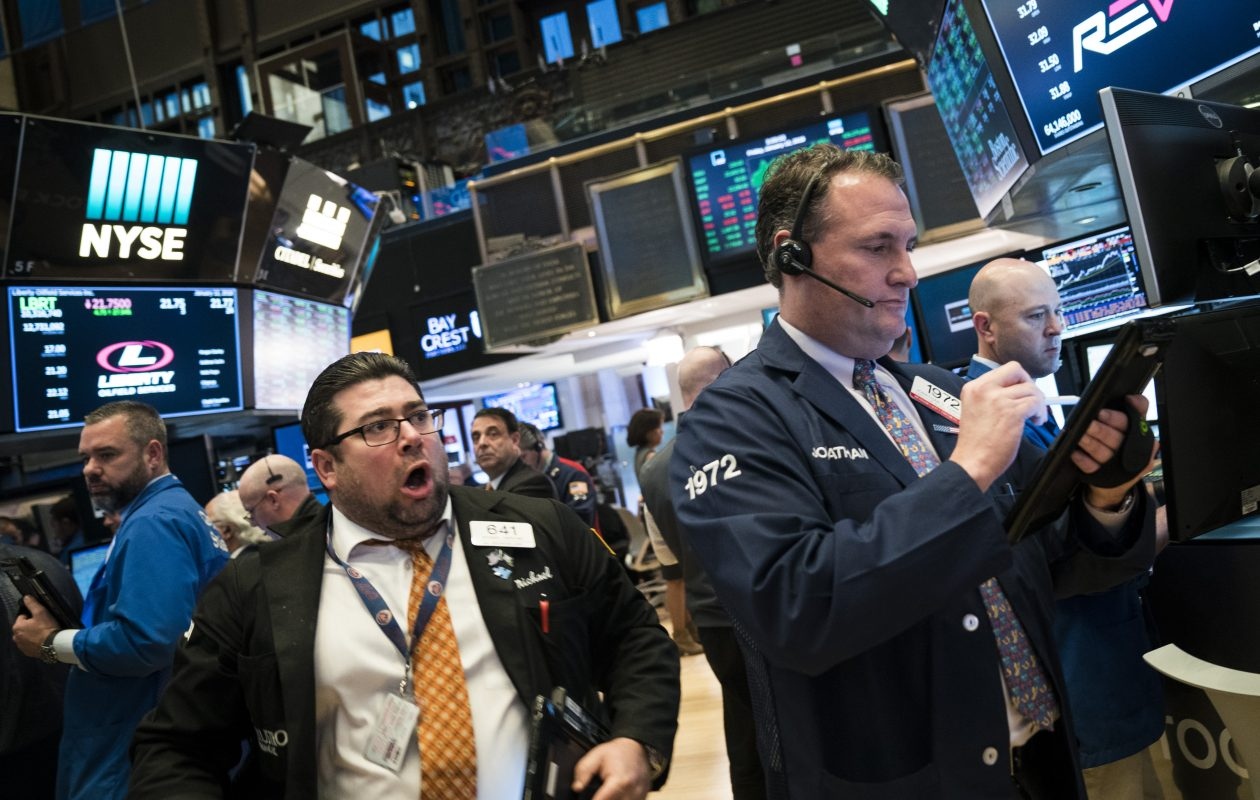 Traders and financial professional work ahead of the closing bell on the floor of the New York Stock Exchange Friday.  TheDow was up over 200 points on Friday, and passed 26,000 Tuesday.  (Photo by Drew Angerer/Getty Images)