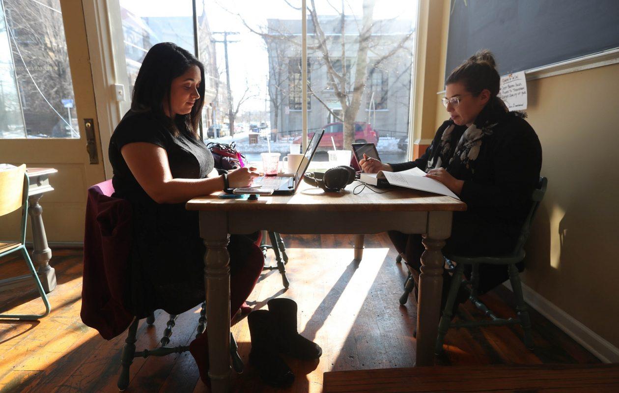 After having brunch at Ashker's, Alyssa Erazo, left, and Bethany Cereo, of Buffalo, study for the bar exam. (Sharon Cantillon/Buffalo News)