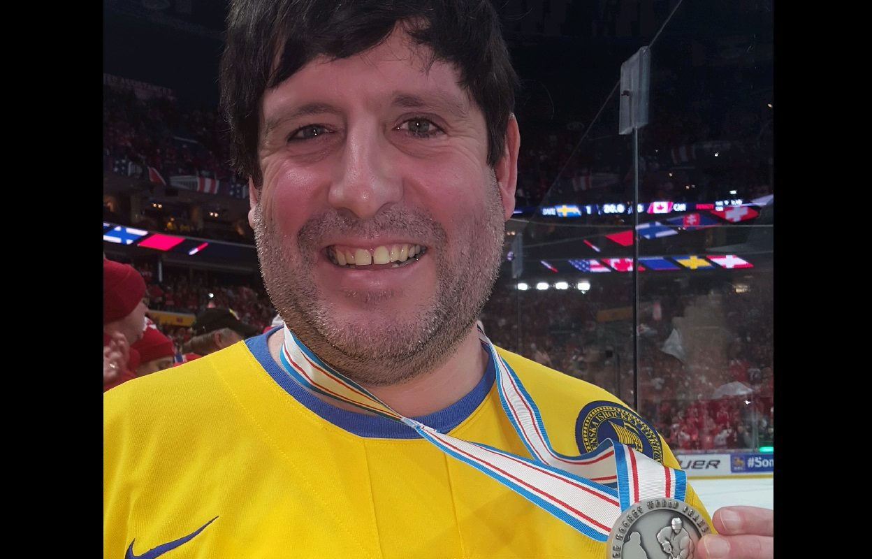 Williamsville native Bill Shaflucas is an internet star after catching the silver medal thrown into the crowd by a Sweden player. (Photo courtesy of Shaflucas)