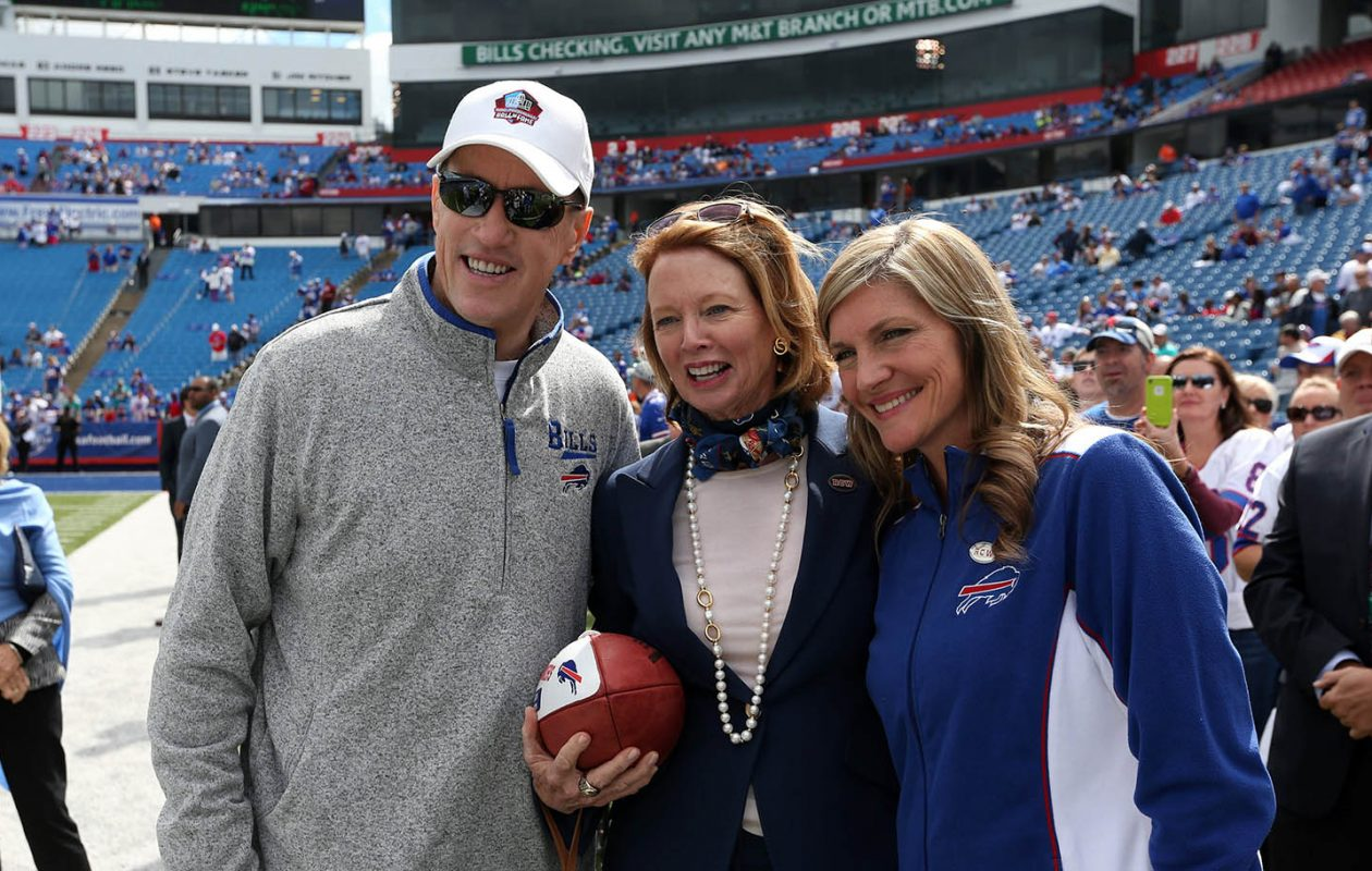 'I just wish Ralph were here to see it,' said Mary Wilson, shown here posing for a photo with Jim and Jill Kelly at the Sept. 14 game, of her late husband and former Bills owner. (James P. McCoy/News file photo)