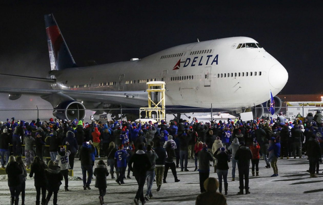 Bills fans flocked to the airport to support the team when their flight arrived in Buffalo  late on New Year's Eve. (Derek Gee/Buffalo News)