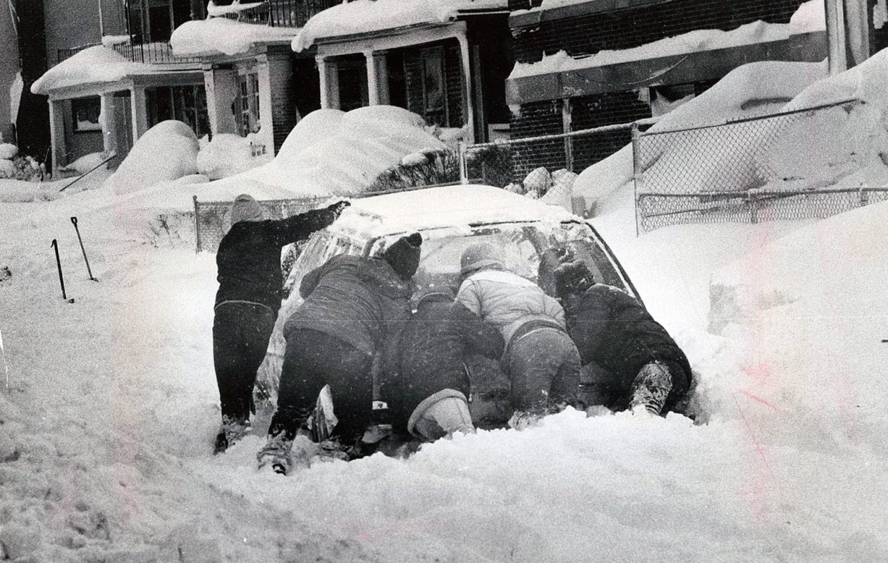 Five people tried to get this car unstuck on Parkdale Avenue in Buffalo. (News file photo)