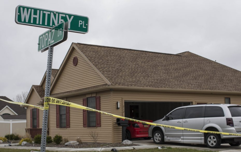 Cheektowaga Police vehicles are stationed outside the Whitney Place home where Sirwilliam Hardy fatally shot his father in April 2017.   (Derek Gee/Buffalo News file photo)