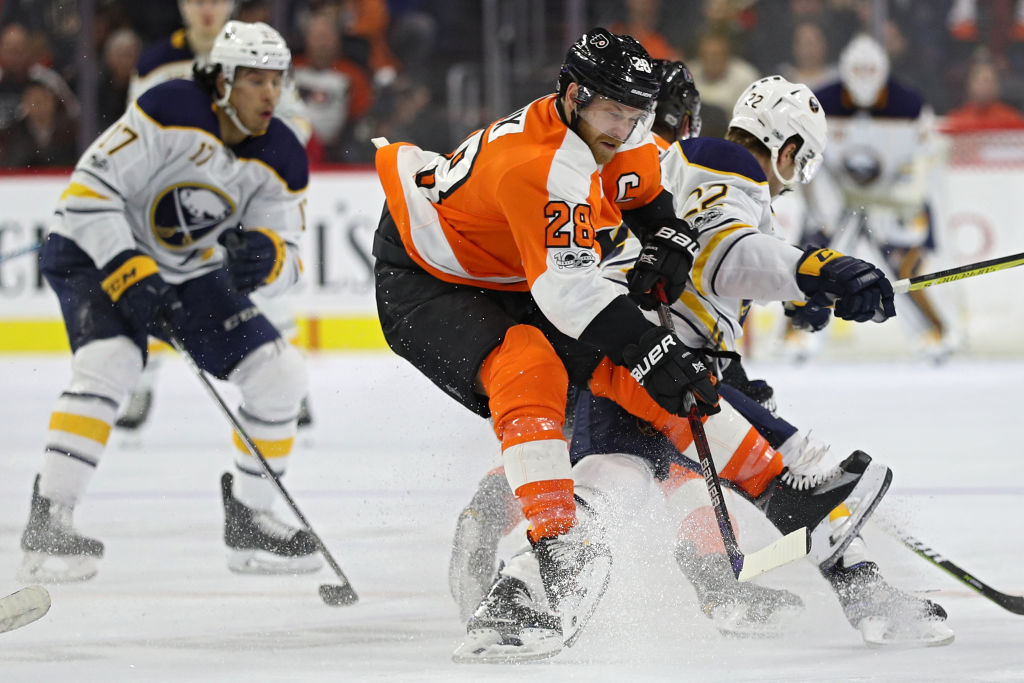 Claude Giroux of the Flyers battles Jordan Nolan and Johan Larsson during the #Sabres' 2-1 loss Dec. 14 in Philadelphia (Getty Images).