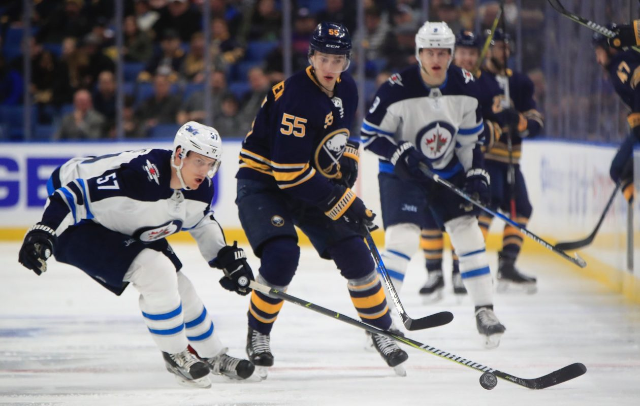 Winnipeg's Tyler Myers (57) and Buffalo's Rasmus Ristolainen offered a glimpse of defensive past and present. (Harry Scull Jr./Buffalo News)