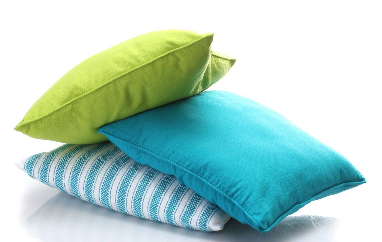 Bring more color into your decor this year with accessories such as pillows and throws.