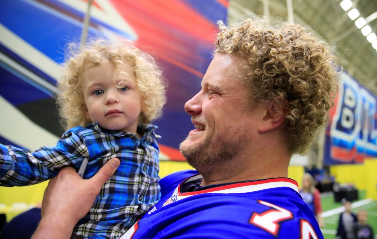 Buffalo Bills Eric Wood holds Landon Lyons, 1, from Amherst during a family fun night with games and activities for children with pediatric cancer at the ADPRO Sports Training Center on Oct. 17, 2017. (Harry Scull Jr./ Buffalo News)