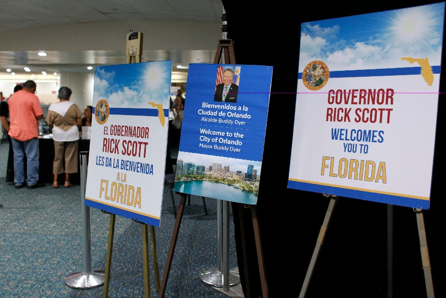 Signs welcoming people are seen at the Reception Center for Puerto Rican refugees set up at the Orlando International Airport in November. (Getty Images)
