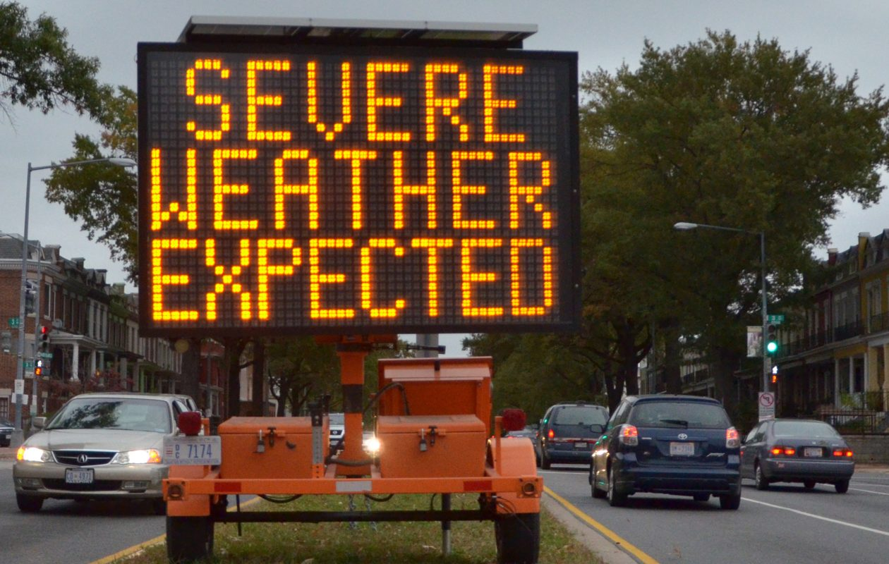 A road sign warns drivers of weather conditions in downtown Washington, D.C., Oct. 28, 2012, ahead of Superstorm Sandy's landfall. (EVA HAMBACH/AFP/Getty Images)