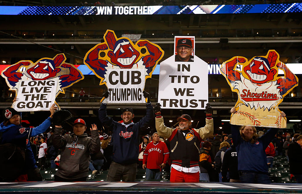 7d8ced7c938 Cleveland Indians fans hold signs based on their Chief Wahoo logo after  Cleveland won Game One of the 2016 World Series at Cleveland s Progressive  Field.