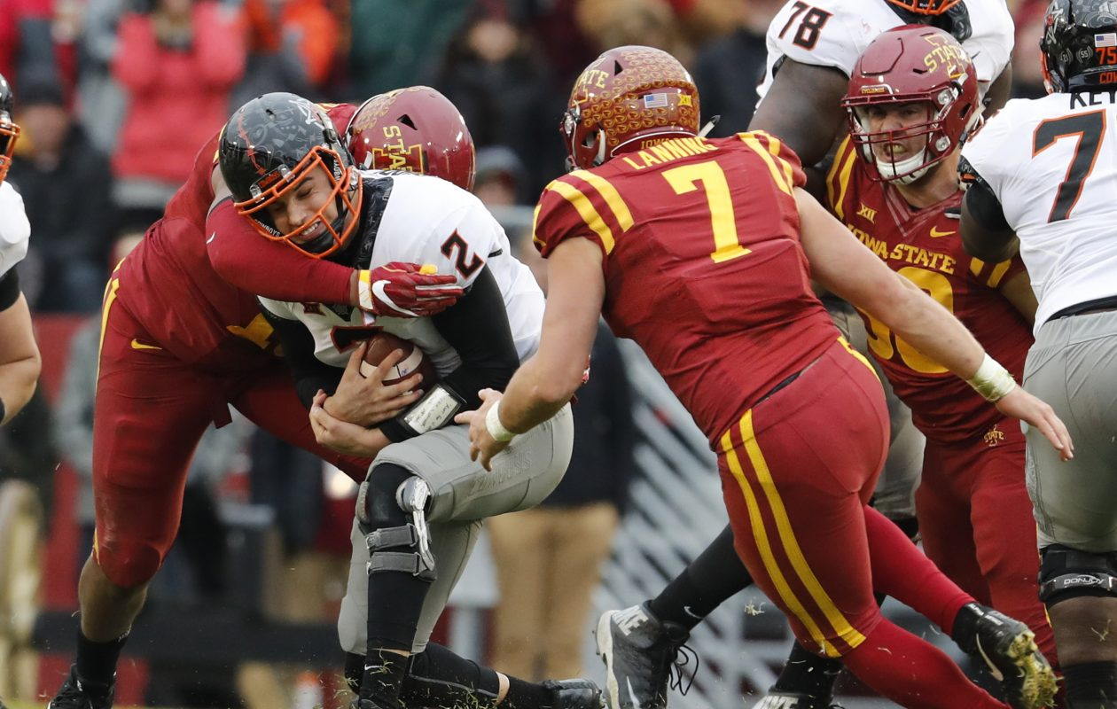 Iowa State's Joel Lanning (7) went from trying to avoid hits to dishing them out when he switched from quarterback to linebacker. (Getty Images)