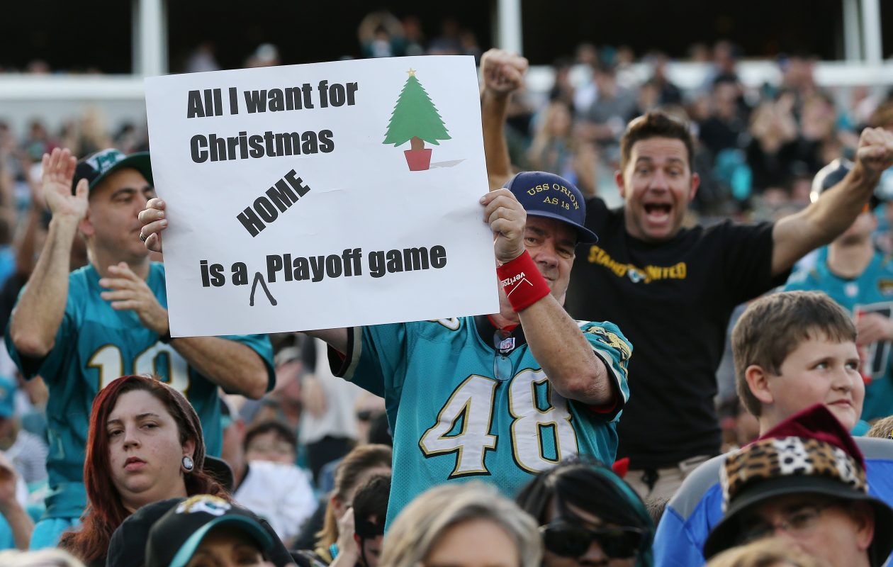 Jacksonville Jaguars fans pose in the stands after the Jaguars defeated the Houston Texans 45-7 at EverBank Field on December 17 in Jacksonville.  Slightly warmer attire will be required for Sunday's playoff in Jacksonville.  (Getty Images)