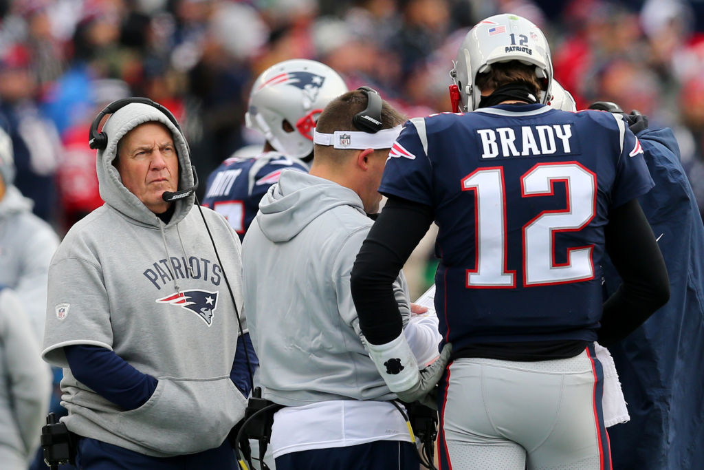 Head coach Bill Belichick of the New England Patriots and Tom Brady #12 on the sideline during the first half against the Buffalo Bills at Gillette Stadium on December 24, 2017 in Foxboro, Massachusetts. (Photo by Maddie Meyer/Getty Images)