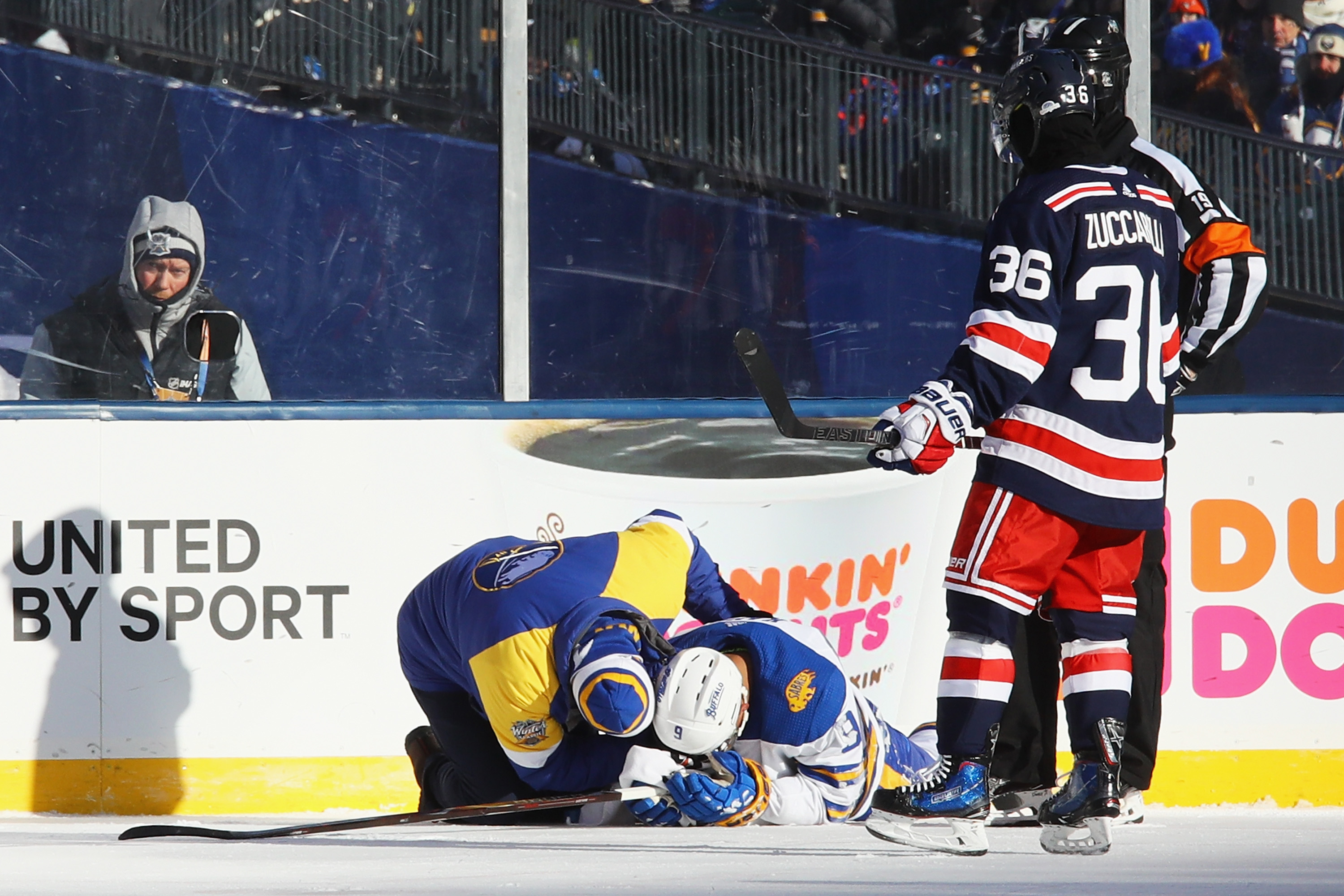 Evander Kane took a stick to the face during the first period. (Getty  Images) 452f8f781