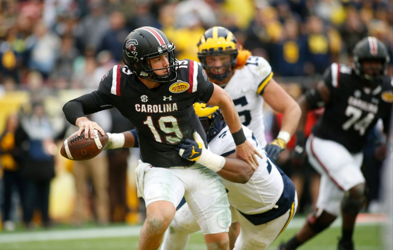 South Carolina quarterback Jake Bentley is taken down by Michigan's Maurice Hurst (Brian Blanco/Getty Images)