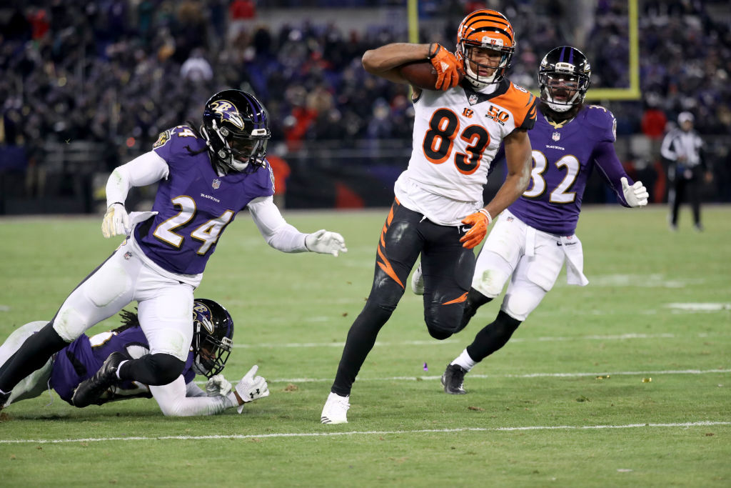 Wide receiver Tyler Boyd of the Cincinnati Bengals runs after making a catch in front of cornerback Brandon Carr and free safety Eric Weddle of the Baltimore Ravens to score the game-winning touchdown in Baltimore Sunday, which sent the Bills to the playoffs. (Getty Images)