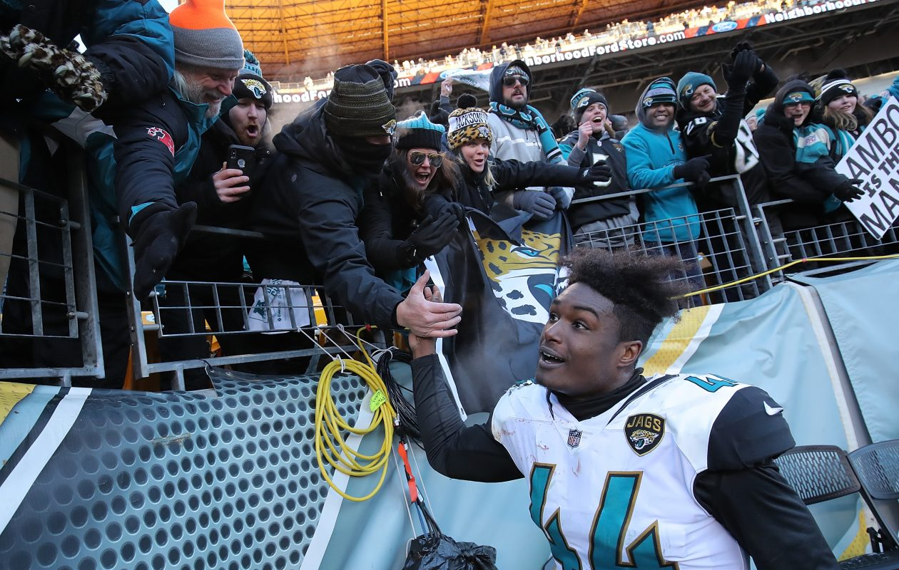 Myles Jack of the Jacksonville Jaguars celebrates with fans. (Getty Images)