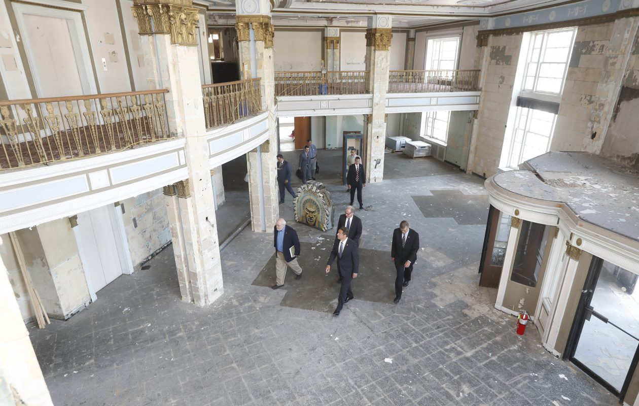 Howard Zemsky, president and CEO of Empire State Development and commissioner of the New York State Department of Economic Development, developer Ed Riley, Niagara Falls Mayor Paul Dyster and Gov. Andrew M. Cuomo walk through the lobby of the Hotel Niagara. (John Hickey/News file photo)