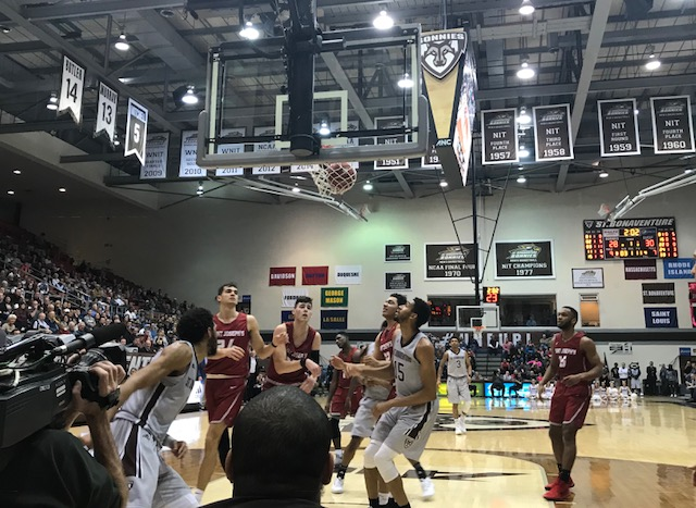 Players jockey for position under the hoop as a St. Bonaventure bucket falls at the Reilly Center. (Nick Veronica/Buffalo News)