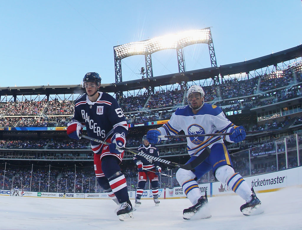 Evander Kane works against Nick Holden of the Rangers during the Winter Classic Monday in Citi Field (Getty Images).