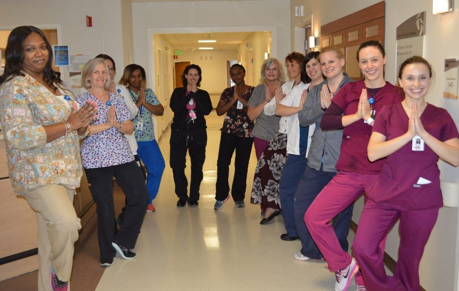 "Laurie Laugeman, second from left, participates in the ""7th-hour stretch"" during a 12-hour shift in the 3-South medical telemetry and neurological unit at Sisters of Charity Hospital.     Laugeman leads the Western New York chapter of the American Holistic Nurses Association. (Carrie Sette-Camara/Special to The News)"