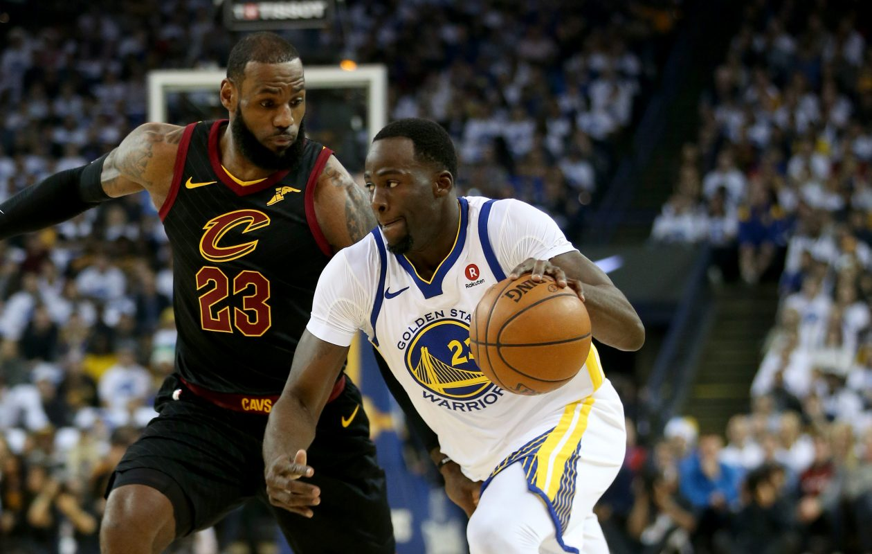 Golden State Warriors' Draymond Green (23) drives past Cleveland Cavaliers' LeBron James (23) in the first quarter of their NBA game at Oracle Arena Monday, Dec. 25, 2017 in Oakland, Calif.  (Bay Area News Group/TNS)