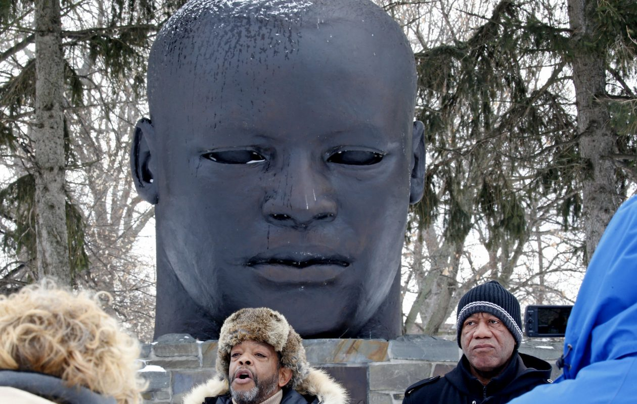 Samuel A. Herbert, left, standing with fellow activist Sylvester Herald, announced Monday, Jan. 15, 2018 their plans to try to replace the Martin Luther King bust at Buffalo's Martin Luther King Park with an alternative statue that looks more like the assassinated civil rights legend.  (Robert Kirkham/Buffalo News)
