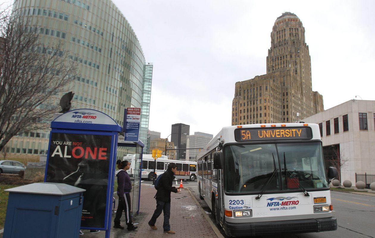 An NFTA bus picks up riders on Niagara Street  in Buffalo in this file photo from Jan. 14, 2013.   (Sharon Cantillon / Buffalo News)