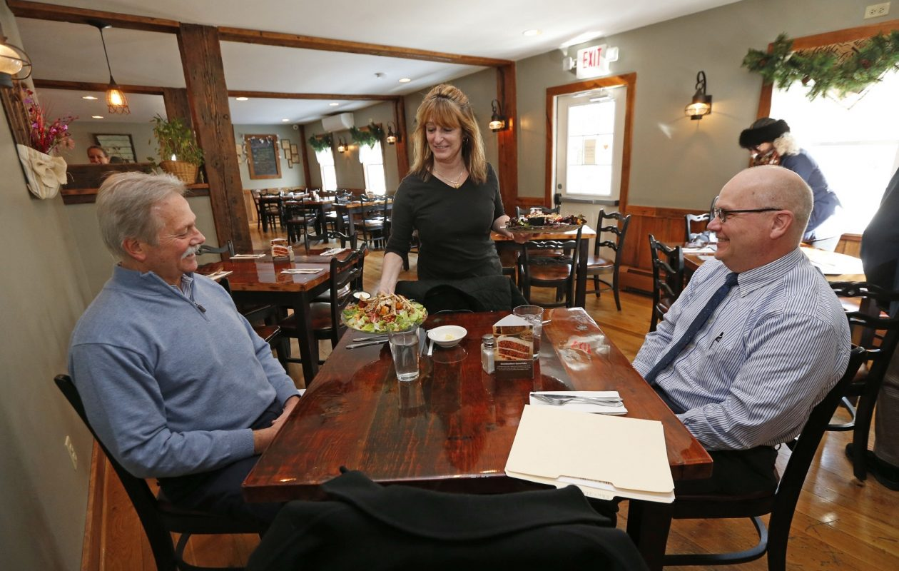 North Star Tavern server Jackie Persico brings out fresh salads to customers Bob Wirth, left, of East Aurora and Brian Makey of Elma, who are there for a business meeting. (Robert Kirkham/Buffalo News)