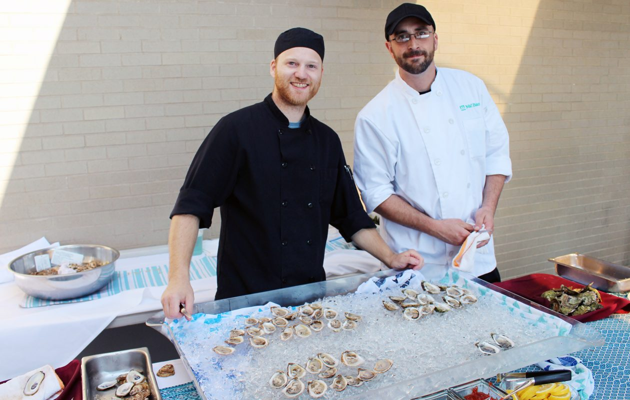 Dan Kirby and Chris Kardach shuck oysters at Ponderoysterfest. (Brennan Carey)