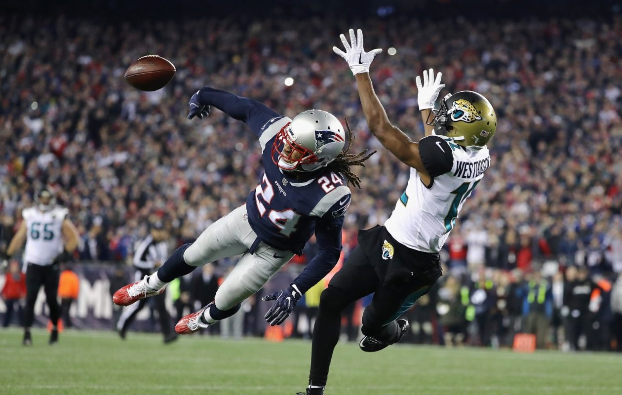 Former Buffalo Bill Stephon Gilmore deflects a pass intended for Dede Westbrook of the Jacksonville Jaguars to seal the Patriots victory and a return trip to the Super Bowl. (Elsa/Getty Images)