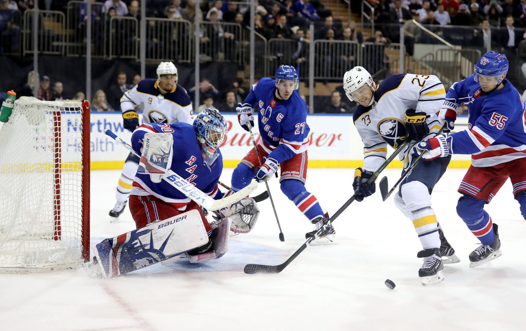 Sabres winger Sam Reinhart (23) battles in front of Rangers goalie Henrik  Lundqvist in c6168de68