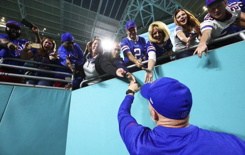 Buffalo Bills head coach Sean McDermott celebrates with fans Sunday after winning against the Miami Dolphins at Hard Rock Stadium in Miami Gardens, Florida. (James P. McCoy/Buffalo News)
