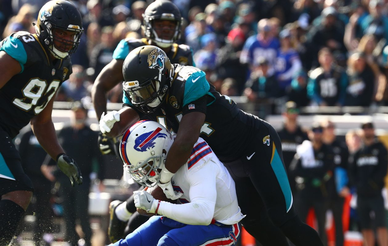 Buffalo Bills quarterback Tyrod Taylor  is tackled by Jacksonville Jaguars in the second quarter. (James P. McCoy / Buffalo News)
