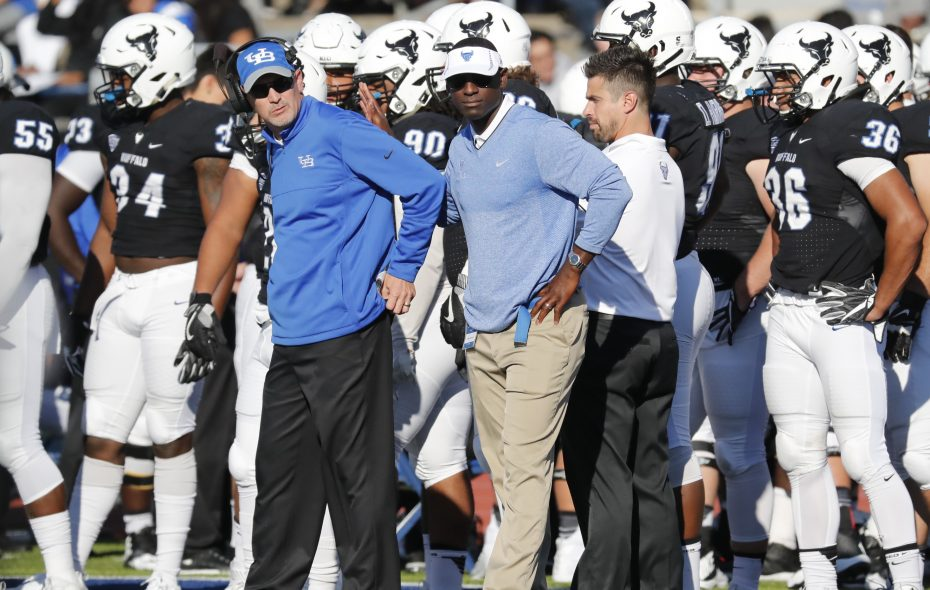 University at Buffalo football coach Lance Leipold, left, and then-athletic director Allen Greene on the sidelines during a 2016 game. (Harry Scull Jr./Buffalo News)