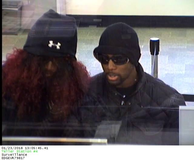 Police released this surveillance camera image of two robbers, one appearing to wear a long, curly wig, held up a bank Tuesday on Tonawanda Street. (Provided by the Buffalo Police Department)