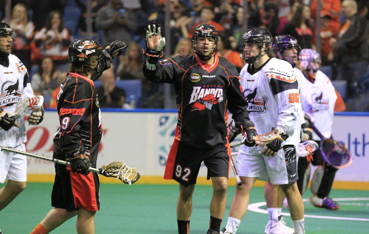 Buffalo Bandit Dhane Smith celebrates a goal in front of Bill O'Brien (96), then with the New England Black Wolves, in 2015. (Harry Scull Jr./Buffalo News)