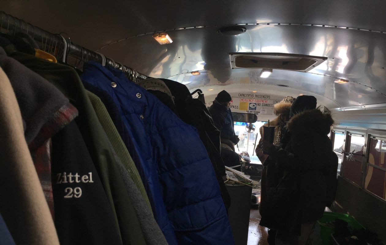 Volunteers sort through coats inside the True Bethel Baptist Church's mobile donation center. (Maki Becker/Buffalo News)