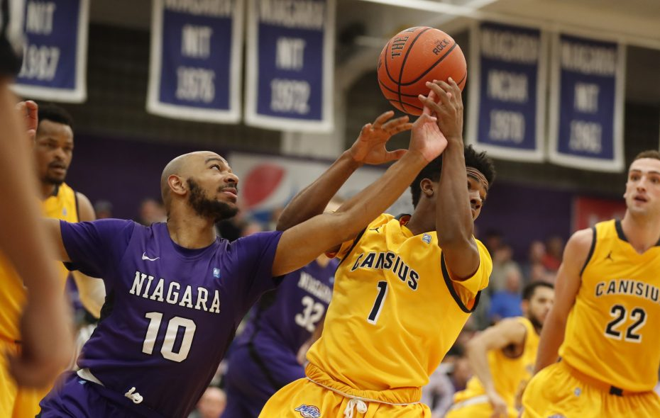Niagara University's Kahlil Dukes and Canisius' Malik Johnson battle for a rebound during second half action at the Gallagher Center on Monday, Jan. 23, 2017. (Harry Scull Jr./Buffalo News)
