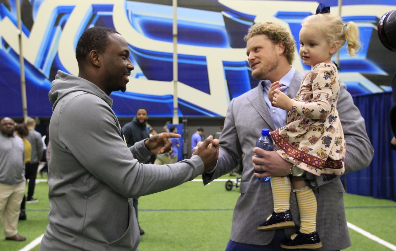 LeSean McCoy greets Eric Wood after Wood announced at a press conference that he will no longer be able to play professional football due to a neck injury. (Harry Scull Jr./Buffalo News)