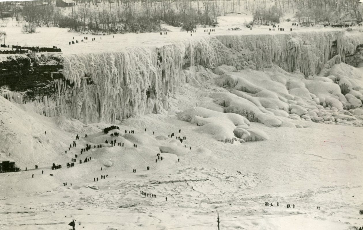 People can be seen crossing the ice bridge that formed in the winter of 1935-36. ( International News Photo file photo)