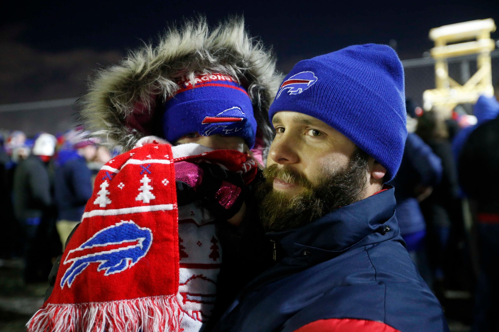 eed60fbc721d7c Brad Simcoe of Cheektowaga brought his 4-year-old daughter, Kaylee, to the  Buffalo International Airport as the Buffalo Bills come home as a playoff  team.