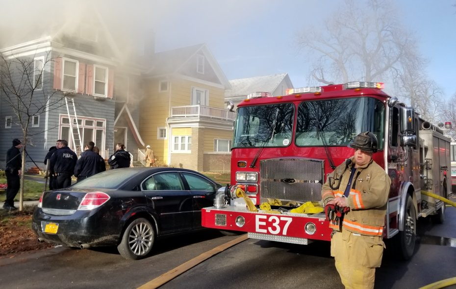 Buffalo firefighters battle a two-alarm blaze that caused extensive damage to this vacant home on Columbus Parkway. (David F. Kazmierczak/Special to The News)