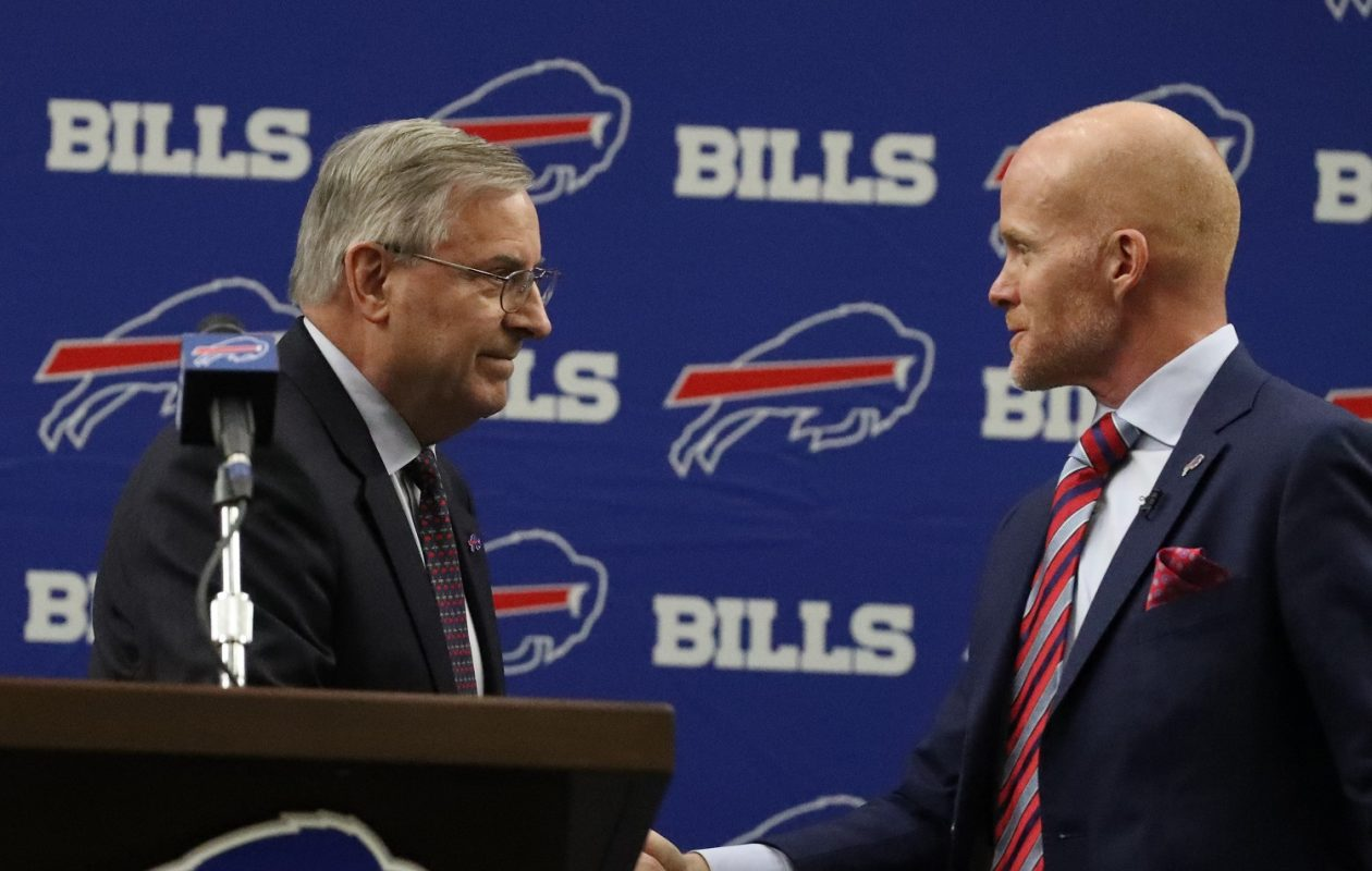 Bills owner Terry Pegula, left, shakes hands with new coach Sean McDermott after introducing him during a press gathering at ADPRO Sports Training Center in Orchard Park N.Y. on Friday, Jan. 13, 2017. (James P. McCoy/Buffalo News)