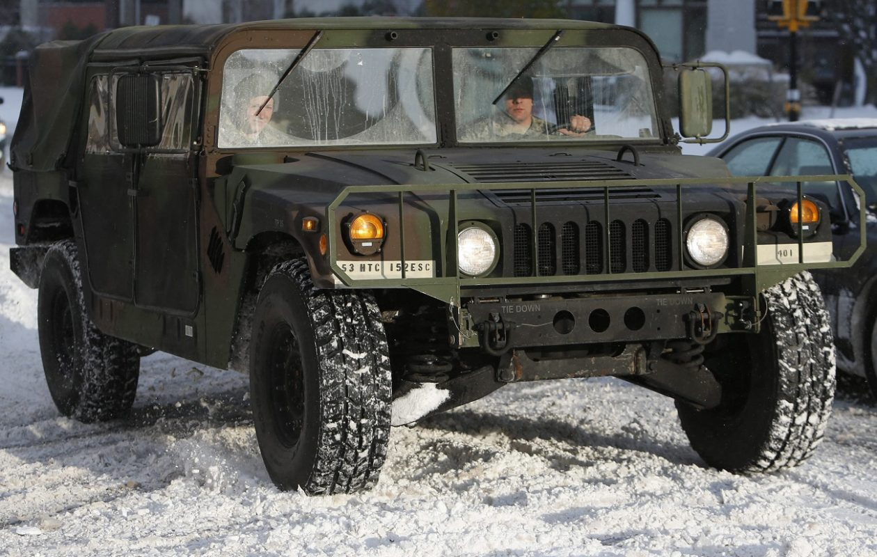 A National Guard vehicle passes down Niagara Street in Buffalo as responder prepare to join the 'Snowvember' storm cleanup effort on Nov. 19, 2014.  (Derek Gee/News file photo)