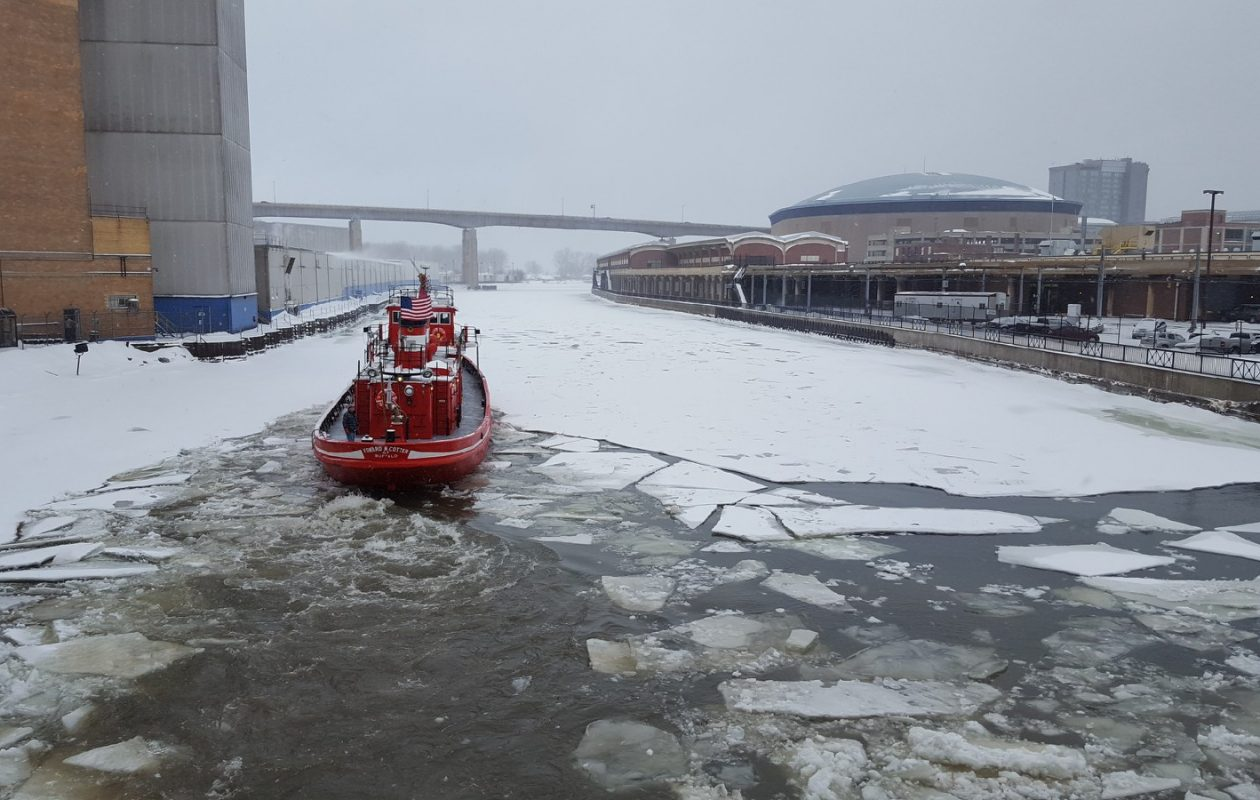 In this provided photo, the Buffalo Fire Department fireboat Edward M. Cotter breaks ice in the Buffalo River on Monday, Jan. 8, 2018, to prevent possible flooding. (Photo courtesy of the City of Buffalo)