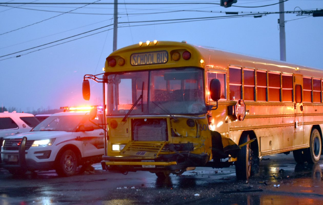 A school bus was damaged in a crash Thursday morning on Saunders Settlement Road. (Larry Kensinger/Special to The News)